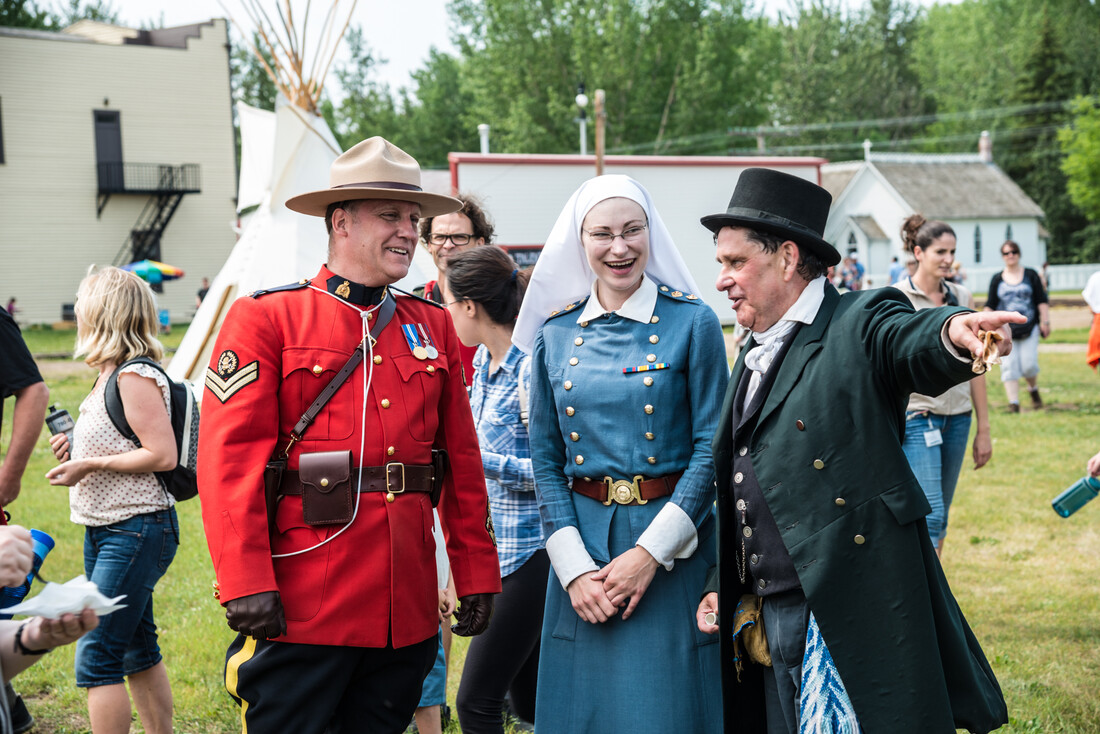 Costumed Interpreters interacting during a Fort Edmonton Park Celebration